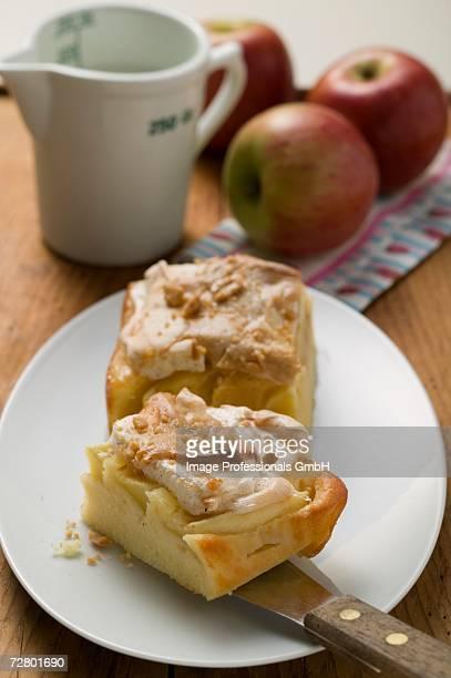 Two pieces of apple meringue cake, fresh apples & milk