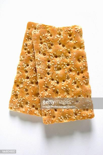 Two pieces of sesame crispbread
