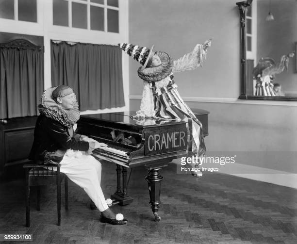 Two Pierrot clowns performing a routine with a piano 1917 A promotional photograph for JB Cramer and Company a Londonbased piano manufacturing firm...