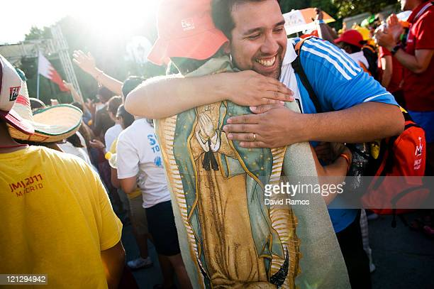Two pilgrims hug each other during a live concert as part of the World Youth Day 2011 on August 17 2011 in Madrid Spain Initiated by Pope John Paul...