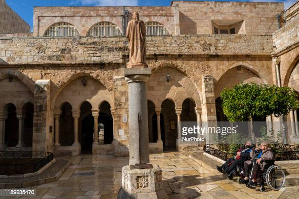 Two pilgrims on 10 December 2019 sunbathe in the cloister of San Jeronimo in the Temple of Santa Catalina is a religious building that is affiliated...
