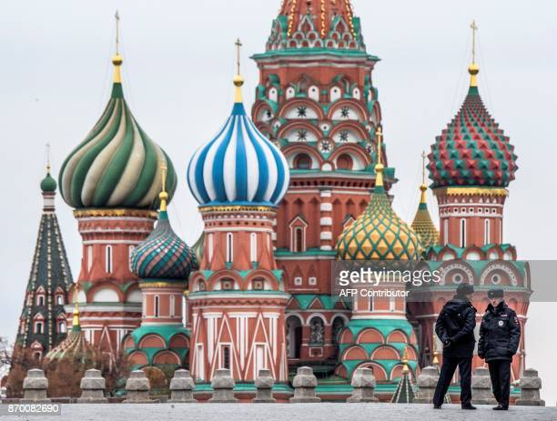 Two pilicemen stand guard on the Red Square in front of St Basil Cathedral on National Unity Day in Moscow on November 4 2017 The National Unity Day...