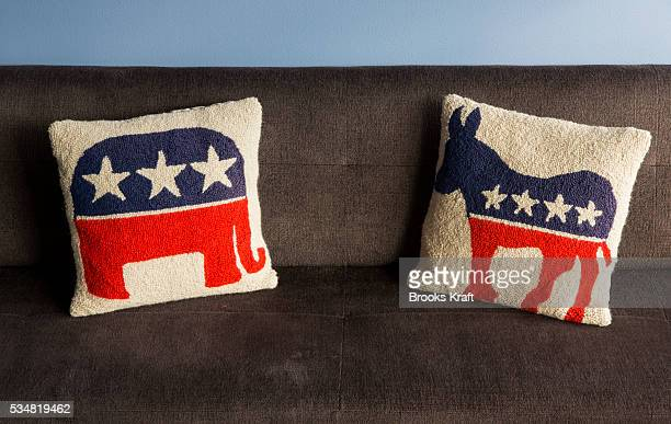 Two pillows on a sofa the Bipartisan Policy Center in Washington DC one with the Democratic Party symbol of a donkey and the other with the...