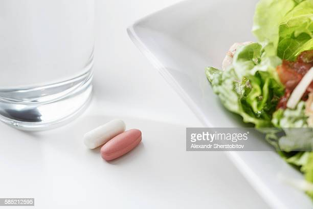 Two pills before eating