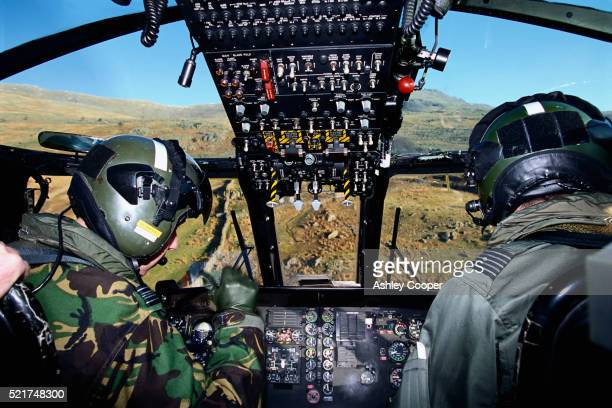 two pilots in rescue helicopter - aviation hat stock pictures, royalty-free photos & images