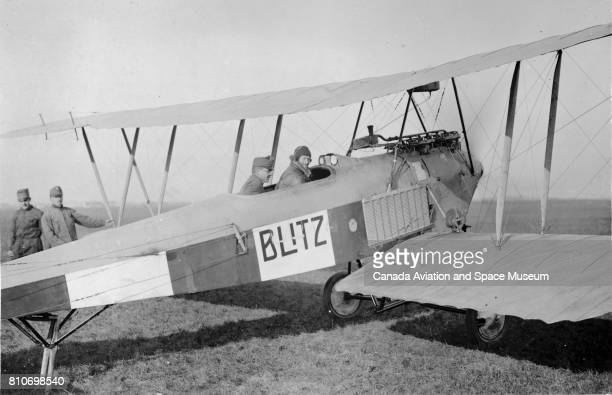 Two pilots sit in the cockpit of a Lohner B I biplane ordered by the Austrian military 1913