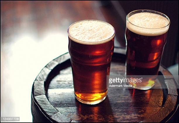 two pints of beer - england stock-fotos und bilder