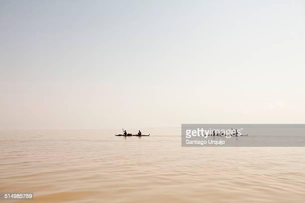 Two pirogues traversing Lake Tana
