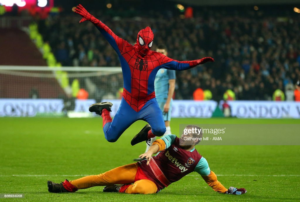 Two pitch invaders, one dressed as Spiderman, run onto the pitch during the Emirates FA Cup Third Round match between West Ham United and Manchester City at London Stadium on January 6, 2017 in London, England.