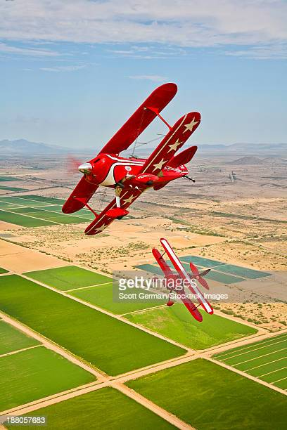 Two Pitts Special S-2A aerobatic biplanes in flight near Chandler, Arizona.