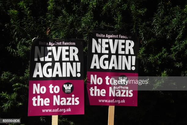 Two placards are seen outside the American Embassy in Central London at the protest against the racism escalation following the riot in...