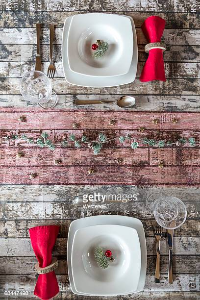 Two place settings on laid table at Christmas time