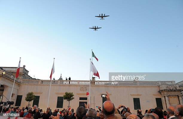 Two planes of the Maltese armed forces fly over St George's Square in the Maltese capital Valletta in honour of Malta's new president on April 4 2014...