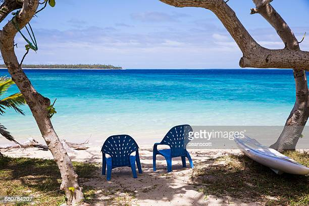 Two plastic chairs on the beach, Tonga