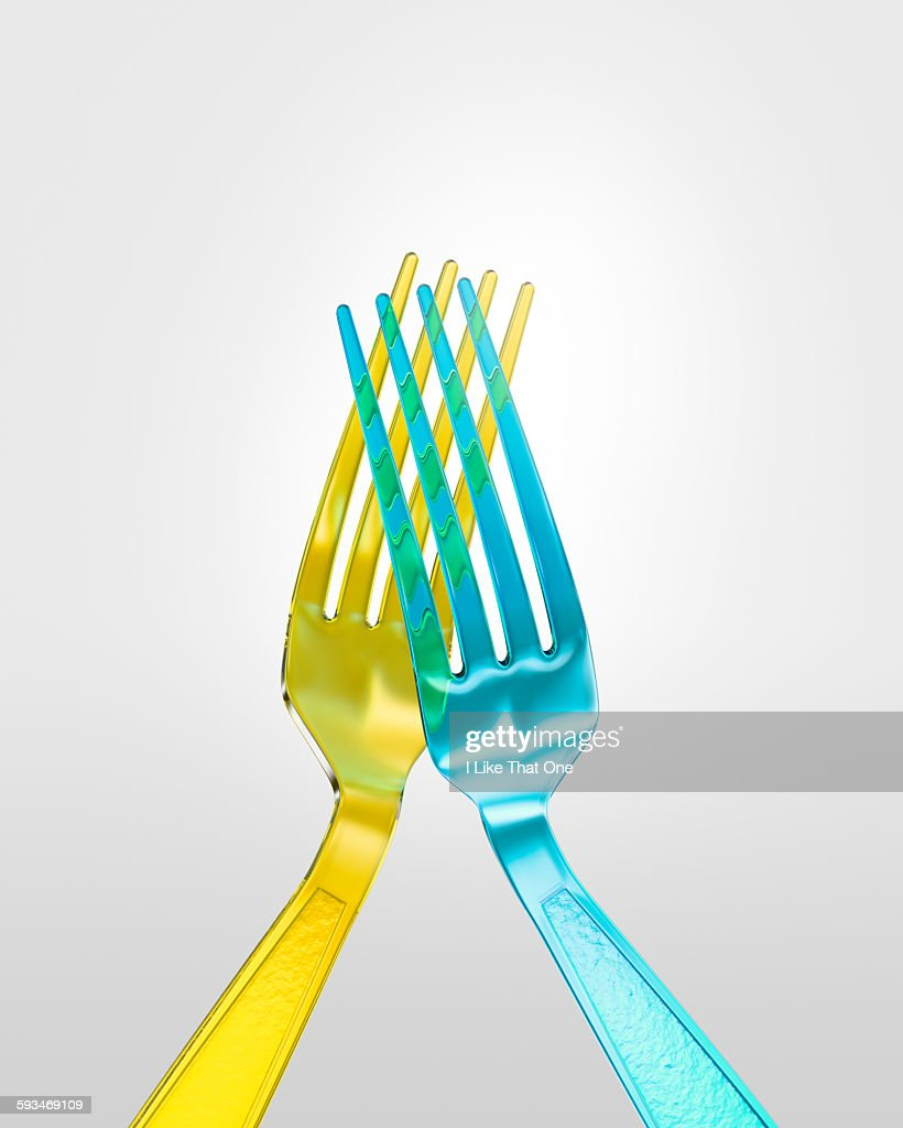 Two plastic forks 'high five-ing' : Stock Photo