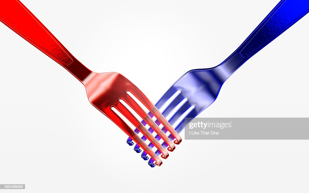Two plastic forks shaking hands : Stock Photo