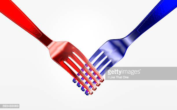 two plastic forks shaking hands - atomic imagery stock pictures, royalty-free photos & images