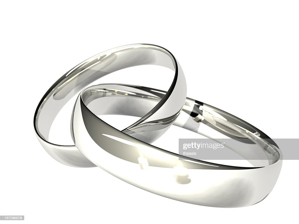 Two Platinum Or Silver Wedding Rings Reflected Candles Stock Photo