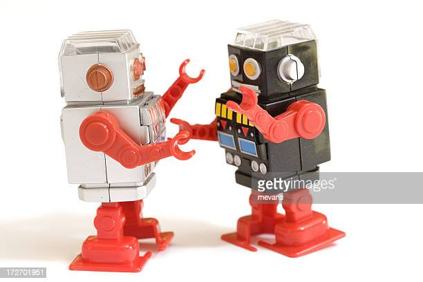 Two play robots on white background
