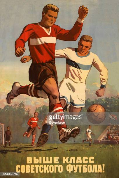 Two players fight for the ball in this Russian poster promoting football early to mid 20th century