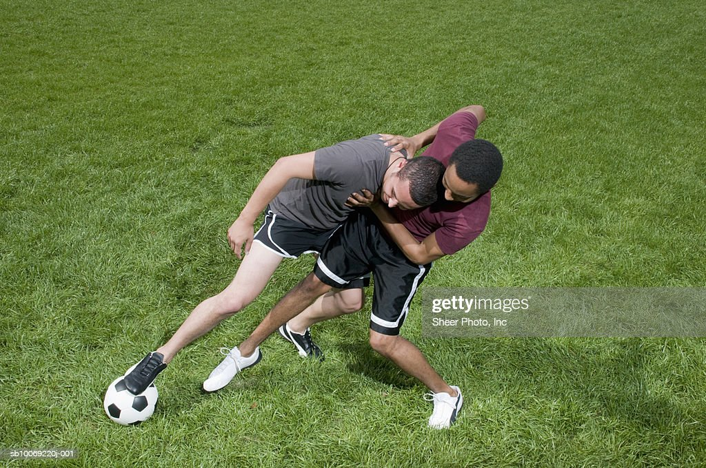 Two players fighting for soccer ball on grass : Stockfoto
