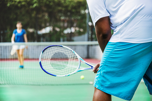 Two players in a tennis match 965883242