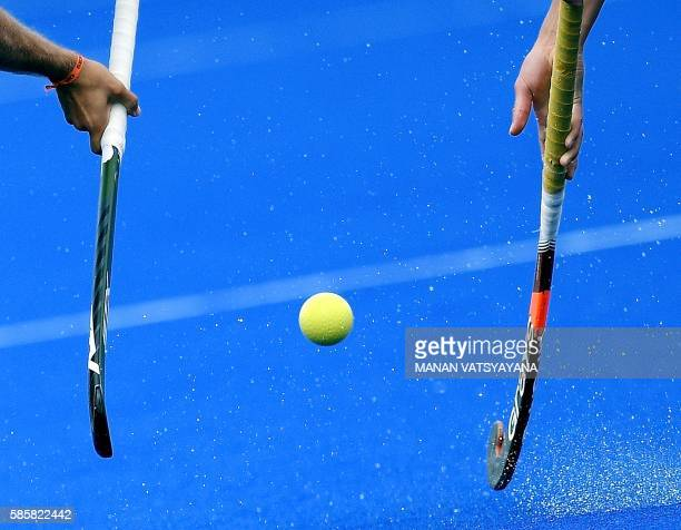 TOPSHOT Two players of Netherlands' men's hockey team take part in a training session at the Olympic Hockey Centre in Rio de Janeiro on August 4 2016...