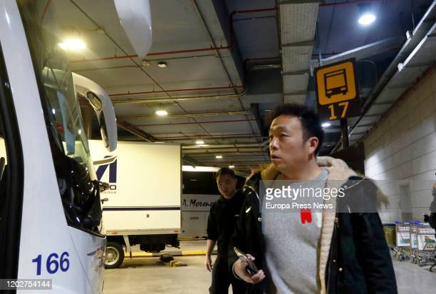 Two players of the football team of Wuhan 'Ground Zero' of the Coronavirus walk at the Airport of Malaga after the arrival of the team for preseason...