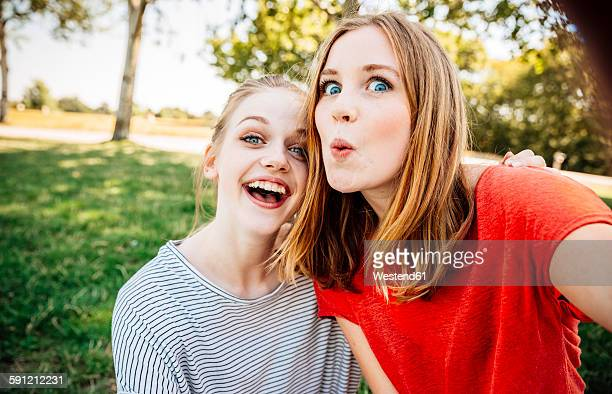 Two playful teenage girls taking a selfie