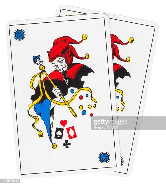 two playing card joker devil style - joker card stock photos and pictures