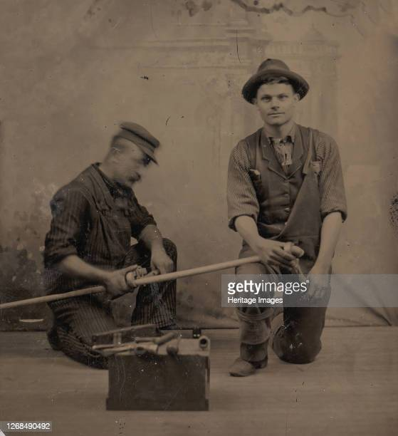 Two Plumbers with a Pipe, Pipe Cutter, and Toolbox, 1870s-80s. Artist Unknown.