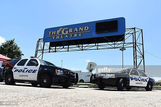 Two police cars sit near the Grand Theatre on July 24, 2015 in Lafayette, Louisiana. Two People were killed and nine others wounded when a shooter...