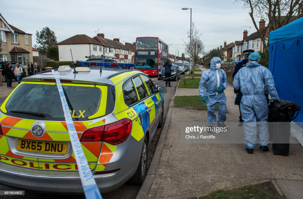 Two police forensics officers prepare to enter a police tent outside the home of Russian exile Nikolai Glushkov who was found dead at his home in New Molden on March 14, 2018 in London, England. Metropolitan police have said the counter-terrorism command unit was leading the investigation into the man's death, the cause of which is not yet clear.