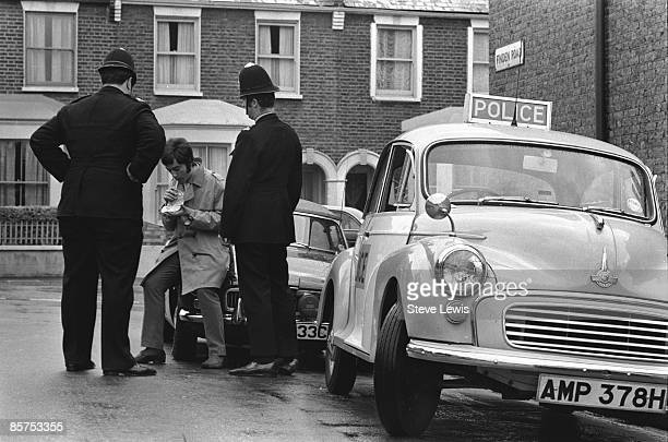 Two police officers administer a Breathalyser test to a driver on Finden Road in Newham in the East End of London 1960s