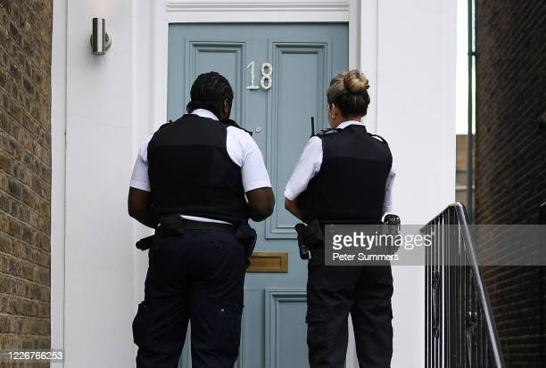 Two police officers arrive at the home of Dominic Cummings, Chief Advisor to Prime Minister Boris Johnson, on May 24, 2020 in London, England. On...