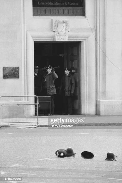 Two police officers breaking in the Libyan People's Bureau in St James's Square following the shooting of police officer Yvonne Fletcher London UK...