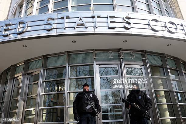 Two police officers guard an entrance of the Federal Courthouse in New York's borough of Brooklyn where two of three Brooklyn residents who have been...