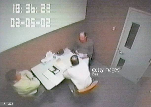 Two police officers interrogate David Westerfield February 5 2002 in San Diego California Westerfield was questioned in the disappearance of Danielle...