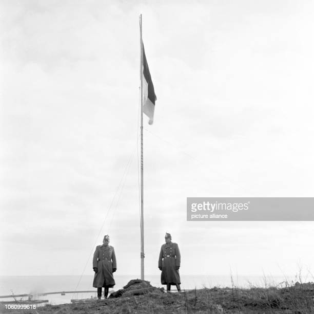 Two police officers keeping honor guard at the flag of Helgoland The island of Helgoland was committed back to Germany by the British government on...