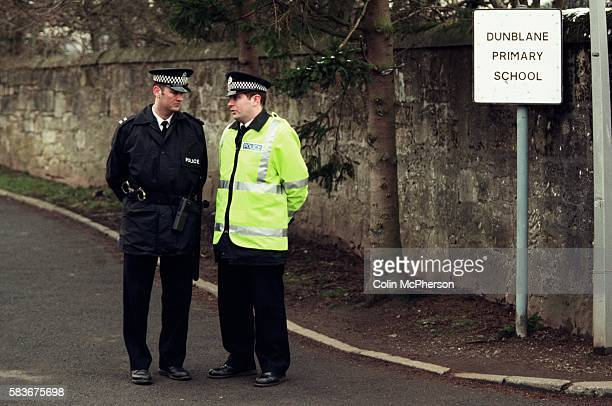 Two police officers on guard outside Dunblane primary school Scotland shortly after the shooting incident on the premises The Dunblane school...