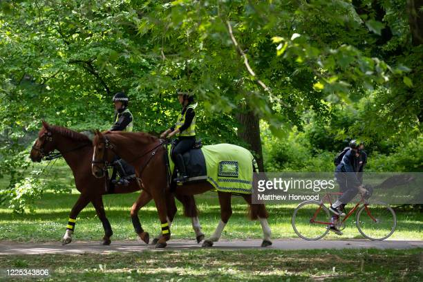 Two police officers on horses patrol Bute Park during the coronavirus lockdown period on May 16, 2020 in Cardiff, United Kingdom. The prime minister...