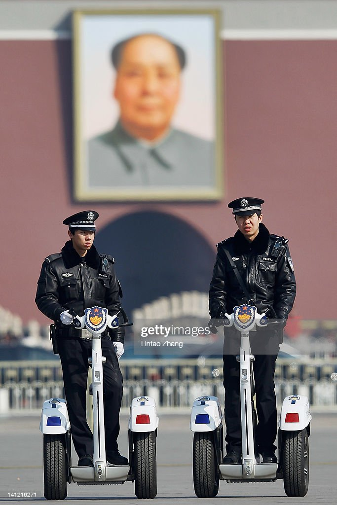 Two police officers on motorized vehicles patrol at Tiananmen Square after the closing session of the National Committee of the Chinese People's Political Consultative Conference (CPPCC) on March 13, 2012 in Beijing, China. Known as 'liang hui,' or 'two organizations', it consists of meetings of China's legislature, the National People's Congress (NPC), and its advisory auxiliary, the Chinese People's Political Consultative Conference (CPPCC).