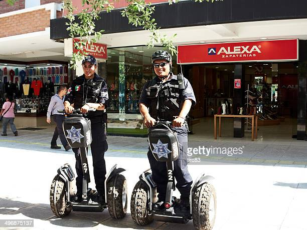 two police officers on segway pt street in downtown monterrey - segway stock pictures, royalty-free photos & images
