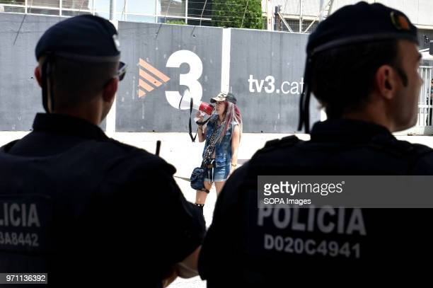 Two police officers watch a demonstrator of the rightwing groups during the protest Hundreds of people fans and groups of the ultra right like...