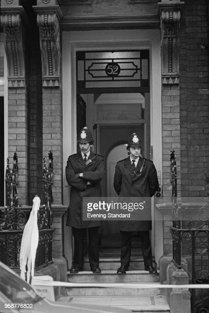 Two policemen guarding the Palestine Liberation Organization offices on Green Street following the assassination of Palestinian diplomat and...