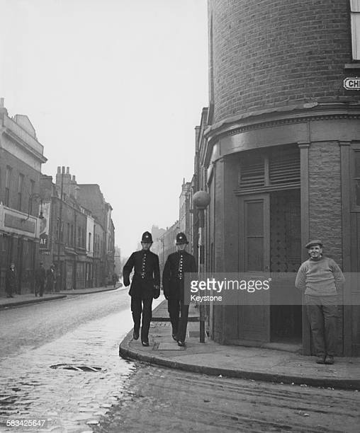 Two policemen on patrol at the corner of Cable Street and Christian Street in the East End of London 13th November 1947