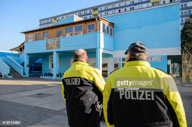 Two policemen secure the Muslim cultural center and mosque following a recent attack just before the beginning of the visit of Aydan Ozoguz German...
