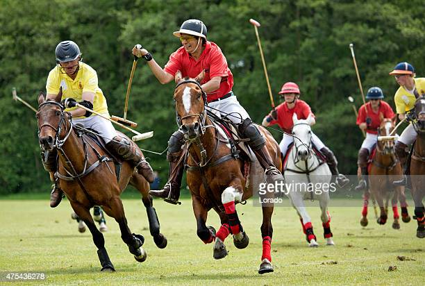 Two polo teams challenging for the ball