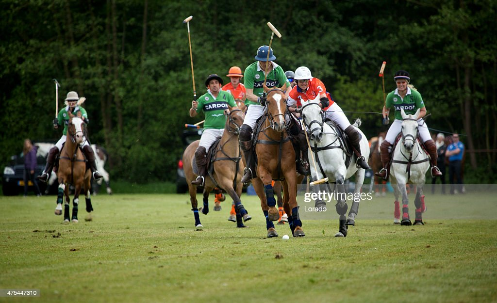 Two polo teams challenging for the ball : Stock Photo