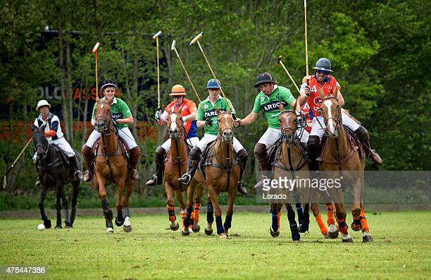 two polo teams challenging for the ball - polo stock pictures, royalty-free photos & images